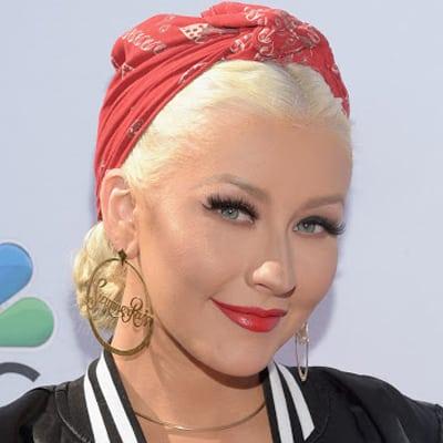 Look sweet yet tough Rosie the Riveter, or Christina Aguilera?