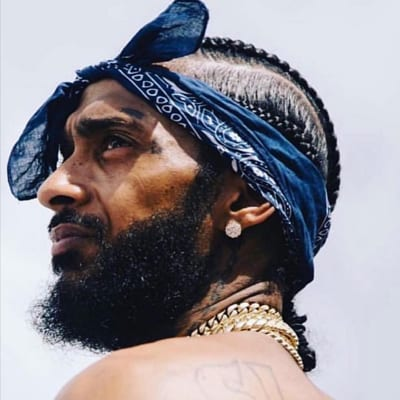 A blue bandana can also create a soulful look like for rapper Nipsey Hussle. RIP